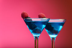 Colourful cocktails garnished with berries. Studio shot royalty free stock photos