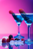 Colourful cocktails garnished with berries Stock Image