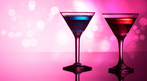 Colourful cocktails on reflective top Royalty Free Stock Image