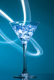 Colourful coctail on the blue background Royalty Free Stock Photos