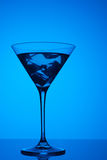 Colourful coctail with ice on the blue background Royalty Free Stock Photo