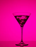 Colourful coctail with ice on the pink background Stock Images