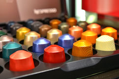 Colourful coffee capsules. Coffee capsules in a variety of colours Royalty Free Stock Photos