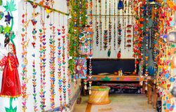 Colourful coffee shop, Pushkar, India. Vaus of decorative wooden elephants and birds in different colors covering the place Royalty Free Stock Photo