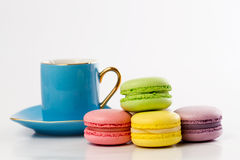 The colourful collection of French macarons, blue mug. Collection of colourful French macarons Royalty Free Stock Photo