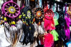 A colourful collection of Indian tokens for sale at the Indian Market in Otavalo in Ecuador. Stock Photography