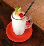 colourful composition of cool Drinks on a red plate with rustic contrast. stock images