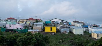 Colourful houses in shanty town on a hill in rural Kwazulu Natal, Wild Coast, South Africa stock images