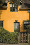 Colourful cottage. Gated old yellow cottage in suffolk uk royalty free stock photo