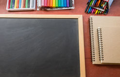 Colourful crayon with book and blackboard Royalty Free Stock Photography
