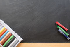 Colourful crayon with book and blackboard Stock Images