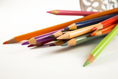 Colourful crayons. On a plane Stock Photos
