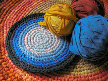 Colourful crochet rag rugs in sunlight Royalty Free Stock Image