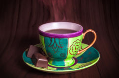 Colourful cup of hot coffee with chocolates Stock Photos
