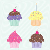 Colourful cupcakes. Set of four colourful party cupcakes on a scribble background Royalty Free Stock Images