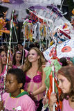 Colourful dancers with models on a street parade Stock Photos