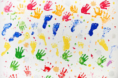 Colourful Design Made From Child's Hand And Foot Prints Royalty Free Stock Images