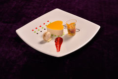 Colourful dessert in the restaurant, mix fruits cake and macaron Royalty Free Stock Images