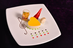 Colourful dessert at restaurant, mix fruits cake and macaron Stock Image