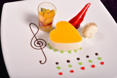 Colourful dessert at restaurant, mix fruits cake and macaron Stock Images