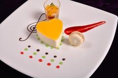Colourful dessert at restaurant, mix fruits cake and macaron Stock Photos