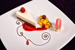 Colourful dessert at restaurant, mix fruits cake and macaron Royalty Free Stock Image