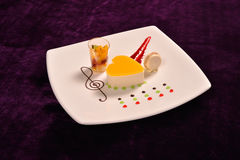 Colourful dessert at restaurant, mix fruits cake and macaron Stock Photo
