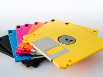 Colourful diskette is thin and flexible magnetic storage medium. A floppy disk, or diskette, is a disk storage medium composed of a disk of thin and flexible Stock Image
