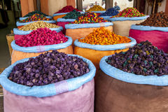 A colourful display of sacks containing various grains, herbs and spices for sale in the Marrakesh medina, Morocco. Royalty Free Stock Images