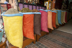 A colourful display of sacks containing various grains, herbs and spices for sale in the Marrakesh medina, Morocco. Stock Images