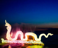 Colourful Dragon on warter twilight. Phayao, Thailand Stock Photos