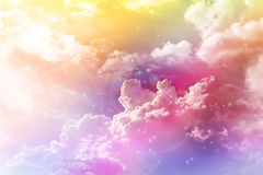 Colourful dreamy puffy clouds sky with lense flare Stock Image
