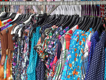 Colourful Dresses Hanging on Market Clothes Rail Royalty Free Stock Photo