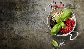 Colourful dried pepper mix and basil Stock Photo