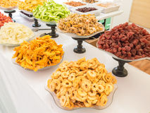 Colourful dry fruit for sale in display dishes. Royalty Free Stock Photo