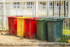 Colourful dustbins in the public area of a port Royalty Free Stock Photography