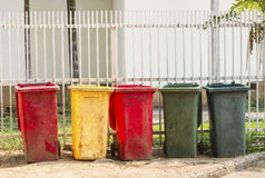 Colourful dustbins in the public area of a port Royalty Free Stock Images
