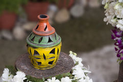 Colourful Earthen Vase. Handmade colourful earthen vase on a stand, India, Asia Royalty Free Stock Photos