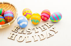 Colourful easter egg in basket Stock Photos
