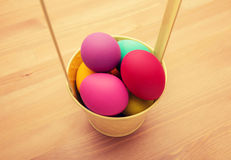 Colourful easter egg in bucket Royalty Free Stock Photo