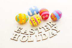 Colourful easter egg with wooden text Royalty Free Stock Images