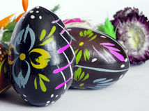 Colourful Easter eggs. Reed on holiday table Stock Photos