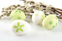 Colourful easter eggs with catkins on white table Royalty Free Stock Photography