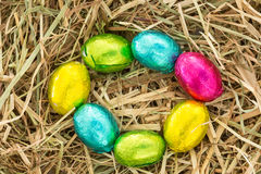 Easter eggs in a circle on straw Royalty Free Stock Photo