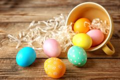 Colourful Easter eggs and cup stock photo