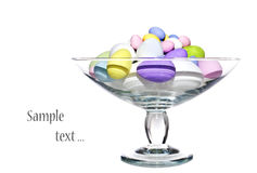 Colourful easter eggs in a glass bowl Stock Photo