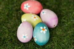 Colourful Easter Eggs on the grass stock images