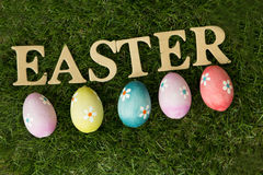 Colourful Easter Eggs on the grass stock image