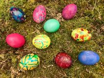 Happy Easter - Colourful Easter eggs in green moss. Royalty Free Stock Photos