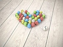 Colourful Easter eggs heart on white wooden floor Stock Photos